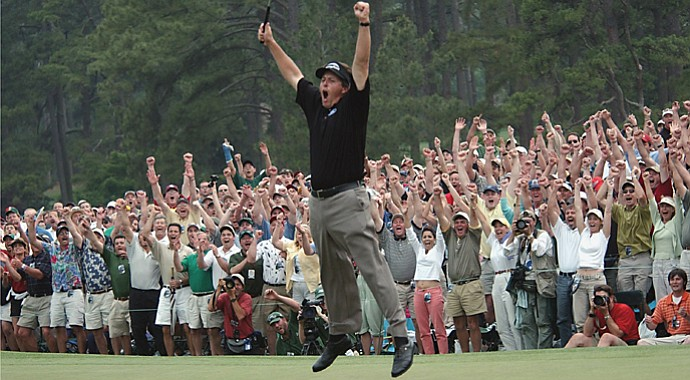 Phil Mickelson celebrates the birdie putt on No. 18 that clinched his first Masters win in 2004.