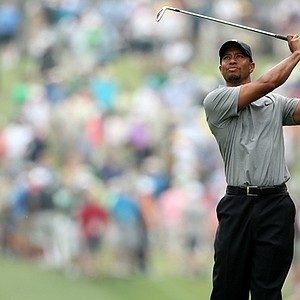 Tiger Woods hits a shot on the first hole during the first round of the 2013 Masters.