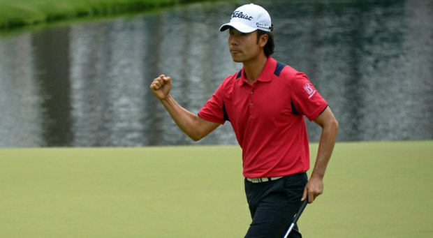 Kevin Na celebrates his eagle on the par-5 15th hole, one of eight on the day at Augusta National.
