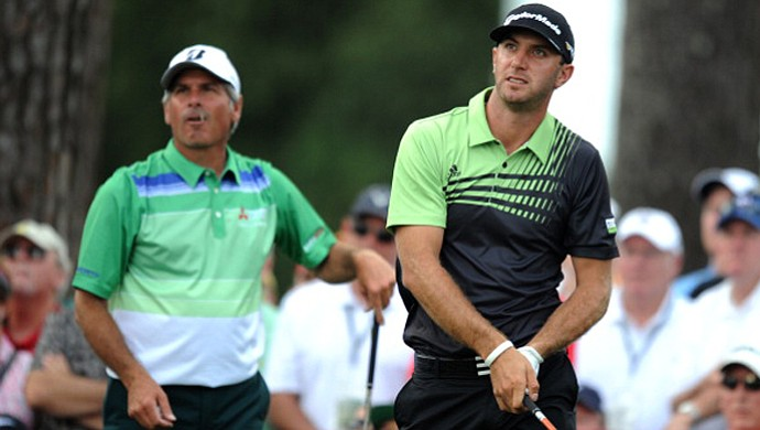 Fred Couples and Dustin Johnson of the U.S. during the first round of the Masters at Augusta National Golf Club.