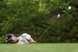 Tiger Woods hits from the No. 4 fairway during Thursday's first round of the 2013 Masters at Augusta National.