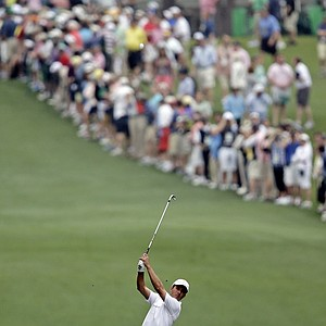 Mike Weir, of Canada, hits off the first fairway during the first round of the Masters golf tournament on Thursday.