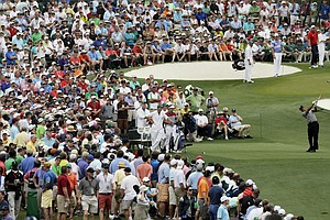 Tiger Woods tees off at No. 3 during Thursday's first round of the 2013 Masters at Augusta National.
