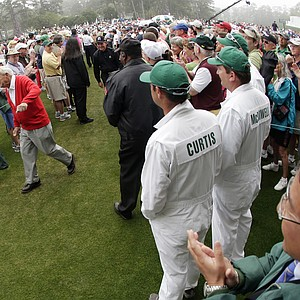 Honorary starter Arnold Palmer walks to the first tee before the first round of the Masters golf tournament Thursday.