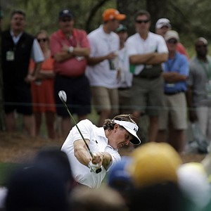 Phil Mickelson hits his third shot on the seventh hole during the first round of the Masters golf tournament.