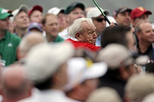 Honorary starter Arnold Palmer hits a ball on the first tee before the first round of the Masters golf tournament Thursday.