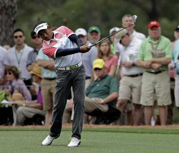 Thaworn Wiratchant , of Thailand, hits on the second fairway during the first round of the Masters.