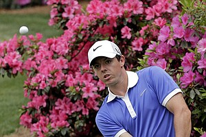 Rory McIlroy, of Northern Ireland, chips to the 13th green during the first round of the Masters golf tournament.