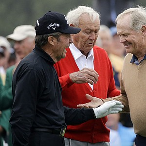 From left, honorary starters Gary Player, Arnold Palmer and Jack Nicklaus chat after hitting on the first tee during the first round of the Masters golf tournament.