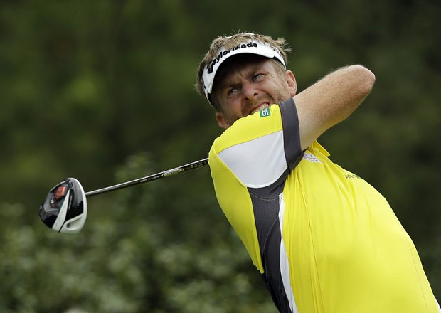 David Lynn, of England, tees off at the 15th hole during the first round of the Masters golf tournament.