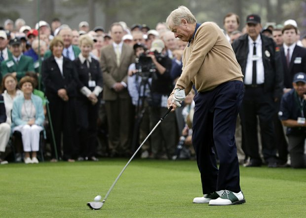 Honorary starter Jack Nicklaus hits a ball on the first tee before the first round of the Masters golf tournament Thursday in Augusta, Ga.