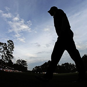 Sergio Garcia, of Spain, walks between the 13th and 14th holes during the first round of the Masters golf tournament.
