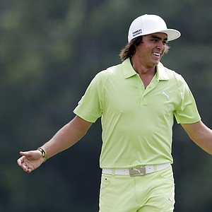 Rickie Fowler reacts on the 18th green during the first round of the Masters golf tournament Thursday, April 11, 2013, in Augusta, Ga.