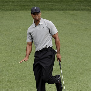 Tiger Woods putts on No. 4 during Thursday's first round of the 2013 Masters at Augusta National.