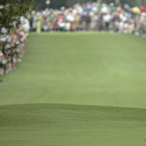 Tiger Woods waits to hit off the first fairway during the first round of the Masters golf tournament on Thursday.