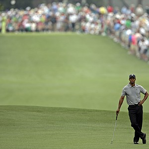 Tiger Woods waits on the No. 1 fairway during Thursday's first round of the 2013 Masters at Augusta National.