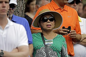Tiger Woods' mother Kultida Woods watches her son during the first round of the Masters golf tournament Thursday, April 11, 2013.