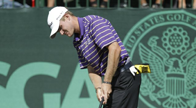 A putter cover sticks out of John Peterson's pocket during the 2012 U.S. Open.