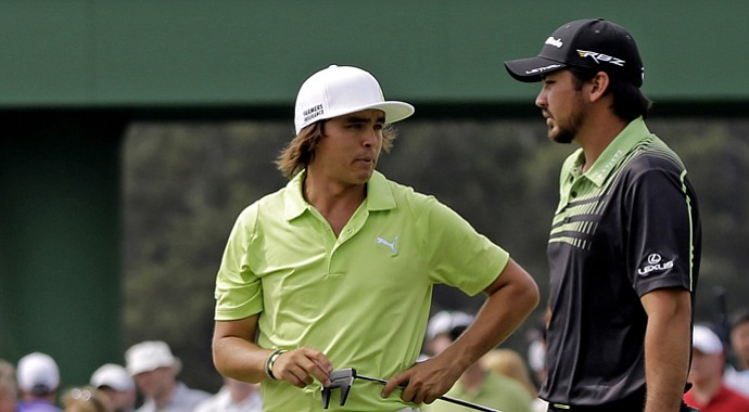 Rickie Fowler talks to Jason Day during the first round of the 2013 Masters.
