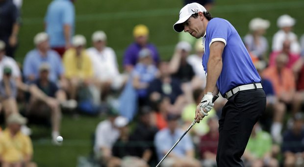 Rory McIlroy, of Northern Ireland, chips to the 15th green during the first round of the 2013 Masters.