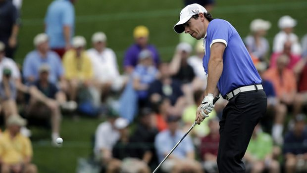 Rory McIlroy, of Northern Ireland, chips to the 15th green during the first round of the Masters.