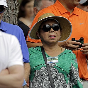 Tiger Woods' mother, Kultida, watches during Thursday's first round of the 2013 Masters at Augusta National.