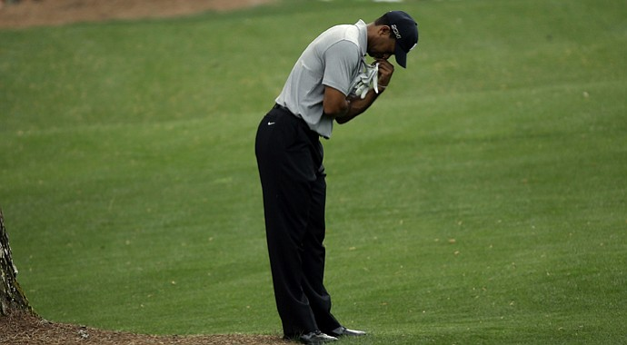 Tiger Woods on the No. 14 fairway during the first round of the 2013 Masters.