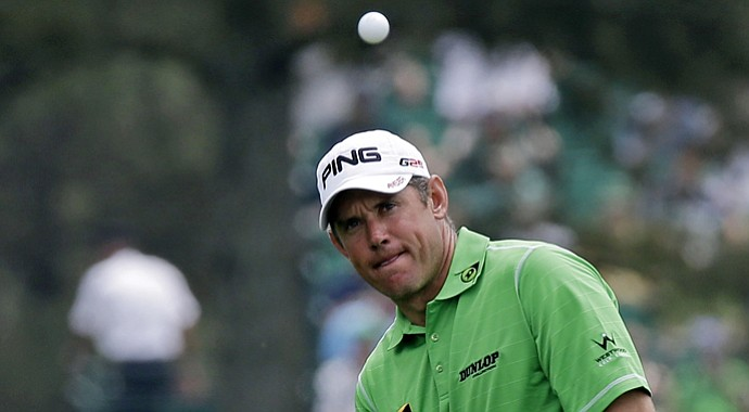 Lee Westwood chips to the 17th green during the first round of the 2013 Masters at Augusta National.