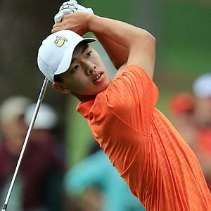 Tianlang Guan hits a shot on the first hole during the second round of the 2013 Masters.