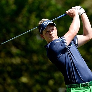 Luke Donald, of England, watches his tee shot on the fourth hole during the second round of the Masters.