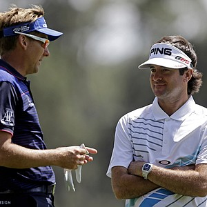 Ian Poulter, of England, chats with Bubba Watson before teeing off on the fourth hole.