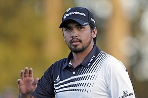 Jason Day, of Australia, waves to the gallery on the 18th hole during the second round of the Masters.