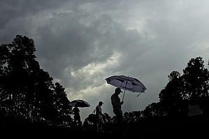 Sergio Garcia (right) walks down the fourth fairway with Adam Scott during the second round of the Masters.