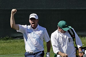 Robert Garrigus celebrates after chipping in for an eagle on the 15th hole during the second round of the Masters.