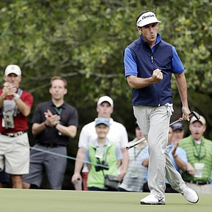 Gonzalo Fernandez-Castano, of Spain, reacts after a birdie on the first green during the second round of the Masters.