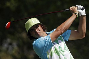 Rickie Fowler tees off on the fourth hole during the second round of the Masters.