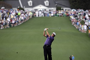 Phil Mickelson hits off the first fairway during the second round of the Masters golf tournament Friday, April 12, 2013.