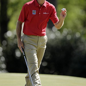 Jim Furyk holds his ball after putting on the 14th hole during the second round of the Masters.