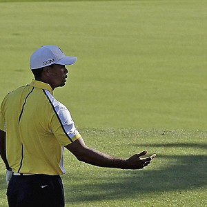 Tiger Woods reacts after his tee shot on the 12th hole during the second round of the Masters.