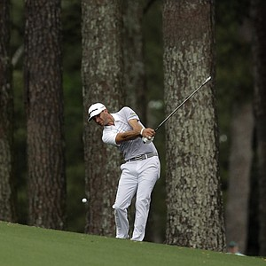 Dustin Johnson hits off the second fairway during the second round of the Masters golf tournament.