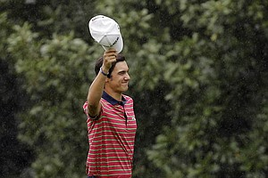Matteo Manassero, of Italy, tips his cap after chipping in for an eagle on the eighth hole during the second round of the Masters.