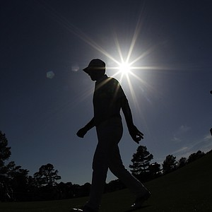 Mike Weir, of Canada, walks to the 18th tee box during the second round of the Masters golf tournament.