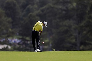 Tiger Woods hits off the second fairway during the second round of the Masters golf tournament.