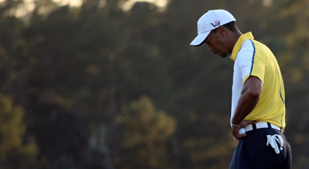 Tiger Woods reacts after a bogey on the 18th hole the second round of the 2013 Masters.