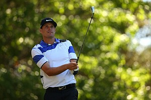 Nick Watney, of the United States, hits a tee shot on the fourth hole during the third round of the Masters.