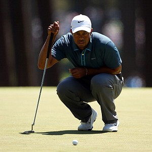 Tiger Woods, of the United States, lines up a putt on the third hole during the third round of the Masters.