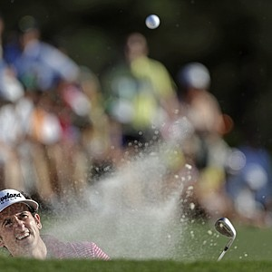 Gonzalo Fernandez-Castano, of Spain, hits out of a bunker on the 18th hole during the third round of the Masters.