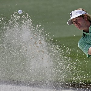 Brandt Snedeker hits out of a bunker on the second hole during the third round of the Masters.