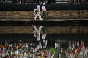 Ryan Moore walks with his caddie to the 15th green during the third round of the Masters.