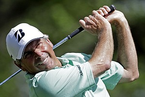 Fred Couples follows through on his tee shot on the fourth hole.